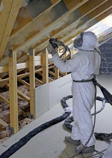 spraying icynene insulation